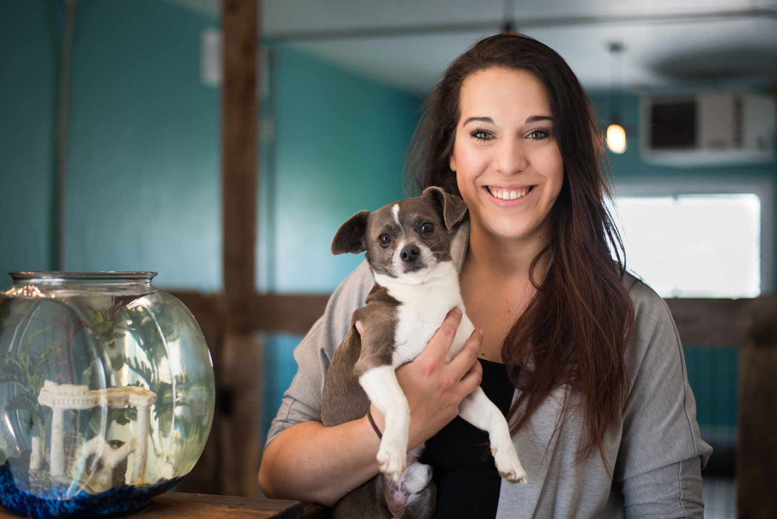 Izy's DogHouse owner posing with small dog